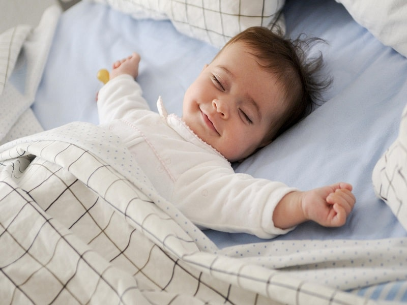 baby sleeping without any fear plate full of delight