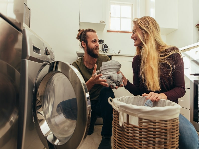 Couple doing laundry plate full of delight