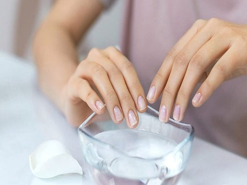 hands in warm water for manicure