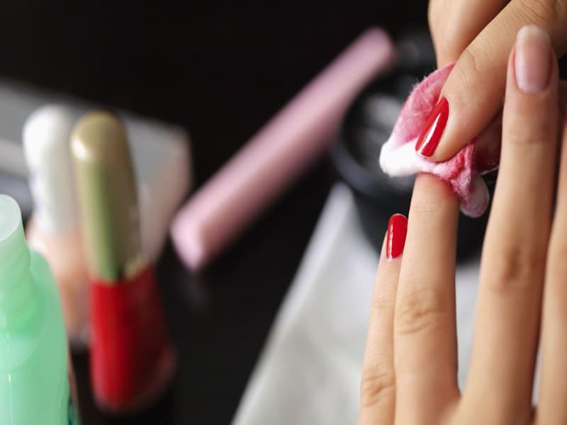 removing nail paint with cotton pad